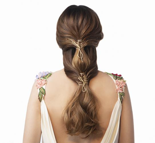 Loose double ponytail with gold cord stitch