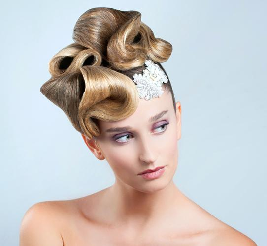 Avant-garde updo with a sculptural headpiece effect