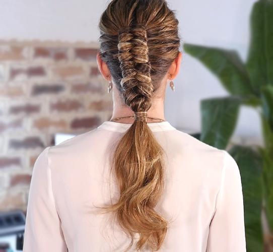 Create an elegant bridal updo with a Dutch infinity braid